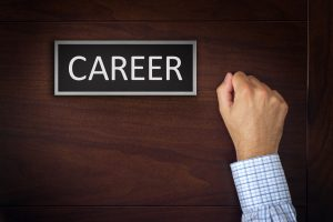Businessman Knocking on Career Office Door