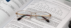 a pair of glasses resting on an accountancy textbook