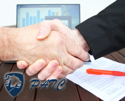 handshake infront of agreement with red pen